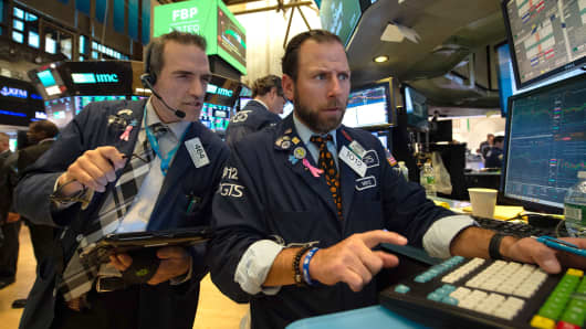 Traders work on the floor of at the closing bell of the Dow Industrial Average at the New York Stock Exchange on October 31, 2018 in New York.