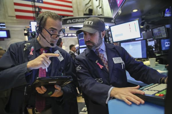 Financial professionals work on the floor of the New York Stock Exchange (NYSE)