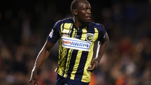 Usain Bolt celebrates scoring a goal for the Central Coast Mariners.