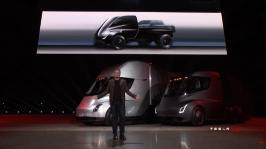 Tesla Chief Executive Elon Musk unveils a sketch of a pickup truck at an event in Hawthorne, California on November 16, 2017.