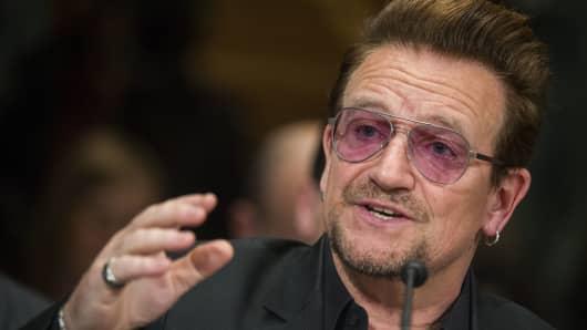 Irish rock star of the band U2 and activist Bono speaks on Capitol Hill in Washington.