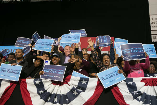 Supporters cheer behind the stage during a campaign rally with Former US President Barack Obama and Georgia Democratic Gubernatorial candidate Stacey Abrams at Morehouse College on November 2, 2018 in Atlanta, Georgia.