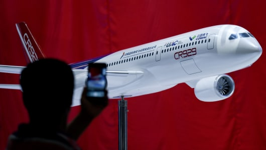 A mock-up scale model of the proposed COMAC C929, a wide-bodied commercial jet to be made by Commercial Aircraft Corporation of China (COMAC) and Russia's United Aircraft Corporation (UAC), is seen on display ahead of the Airshow China 2018 in Zhuhai, in southern China's Guangdong province on November 5, 2018.