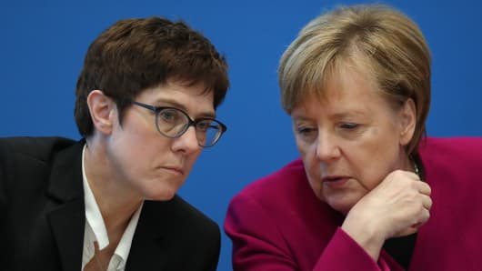 German Chancellor and leader of the German Christian Democrats (CDU) Angela Merkel (R) chats with CDU General Secretary Annegret Kramp-Karrenbauer prior to a meeting of the CDU leadership the day after elections in the state of Hesse on October 29, 2018 in Berlin, Germany.
