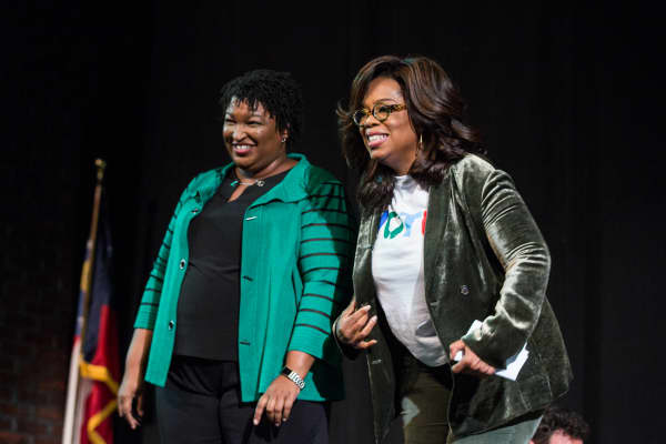 Oprah Winfrey and Georgia Democratic Gubernatorial candidate Stacey Abrams greet the audience during a town hall style event at the Cobb Civic Center on November 1, 2018 in Marietta, Georgia.