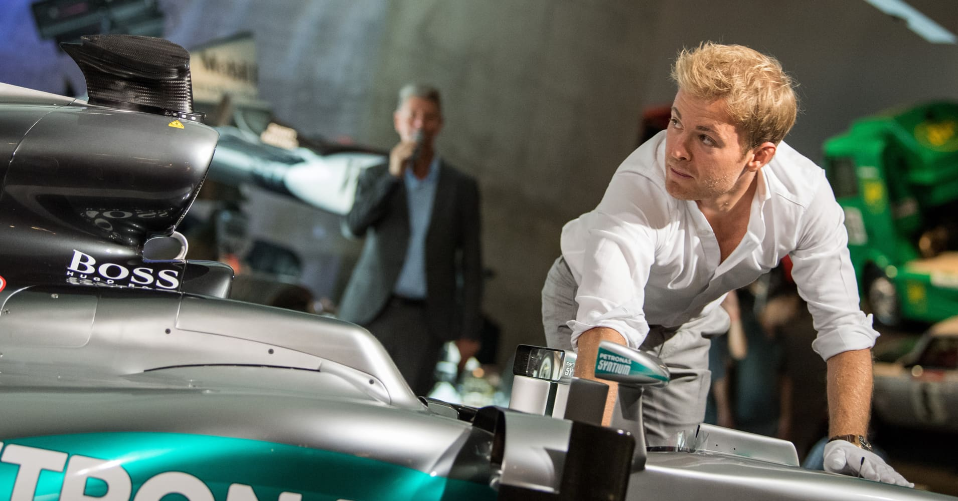 Formula One World champion Nico Rosberg pushes his car during the transfer of his world championship car, a Mercedes F1 W07 hybrid, into the Mercedes-Benz Museum in Stuttgart.