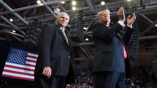 US President Donald Trump alongside radio talk show host Rush Limbaugh arrive at a Make America Great Again rally in Cape Girardeau, Missouri on November 5, 2018.