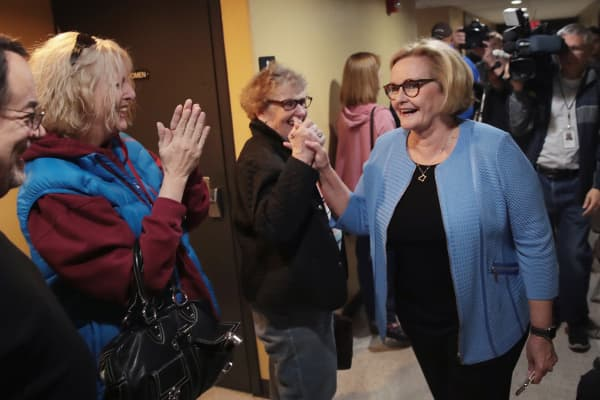 Senator Claire McCaskill (D-MO) is greeted by people waitng to vote as she leaves the polling station after voting on November 6, 2018 in Kirkwood, Missouri.