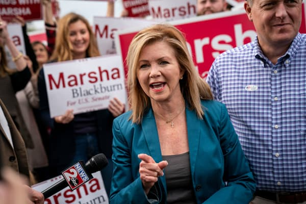 Supporters look on as U.S. Rep. Marsha Blackburn (R-TN), Republican candidate for U.S. Senate, speaks to reporters after she cast her ballot during early voting at the Williamson County Clerk's office, October 31, 2018 in Franklin, Tennessee.