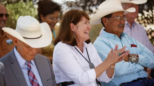 Representative Ann Kirkpatrick, a Democrat from Arizona, center, applauds during a campaign event on the Navajo Nation Native American Reservation ahead of the U.S. Senate election in Tuba City, Arizona, U.S.