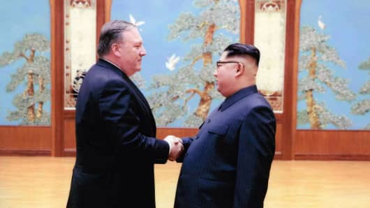 Mike Pompeo (L) shakes hands with North Korean leader Kim Jong Un in this undated image in Pyongyang, North Korea.