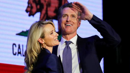 California Democratic gubernatorial candidate Gavin Newsom hugs his wife Jennifer as he celebrates being elected governor of the state during an election night party in Los Angeles, California, November 6, 2018.