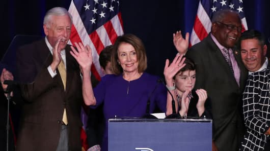 U.S. House Minority Leader Nancy Pelosi celebrates the Democrats winning a majority in the U.S. House of Representatives with House Minority Whip Steny Hoyer (L), her grandson Paul (3rd R), U.S. Rep. James Clyburn (2nd R) and Democratic Congressional Campaign Committee (DCCC) Chairman Ben Ray Lujan (R) during a Democratic midterm election night party in Washington, U.S. November 6, 2018.