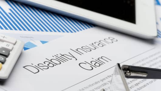 Disability insurance claim form with paperwork