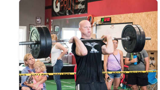 A Twitter post showing Matthew Whitaker weightlifting.