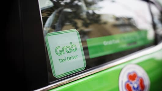 The Grab logo is displayed on a taxi in Bangkok, Thailand, on Friday, March 9, 2018.