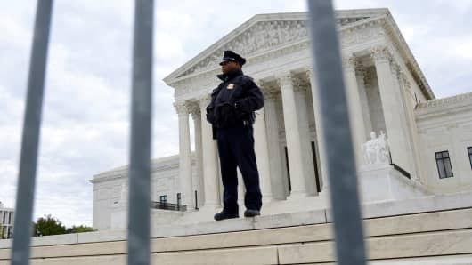 Barriers are in place and police stand guard as a precaution against protests at the Supreme Court for the formal investiture of Associate Justice Brett M. Kavanaugh, attended by President Donald Trump and First Lady Melania Trump, in Washington, November 8, 2018.