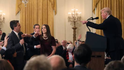 A White House staff member reaches for the microphone held by CNN's Jim Acosta as he questions U.S. President Donald Trump during a news conference following Tuesday's midterm U.S. congressional elections at the White House in Washington, U.S., November 7, 2018.