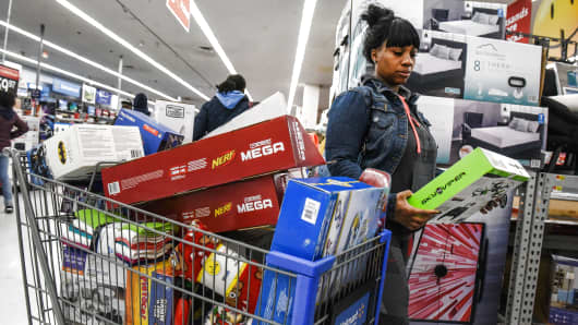 A woman shops at Walmart near the Green Acres Mall on November 24, 2017 in Valley Stream, NY.