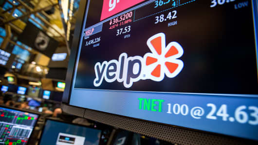 Yelp Inc. signage is displayed on a monitor on the floor of the New York Stock Exchange (NYSE) in New York.