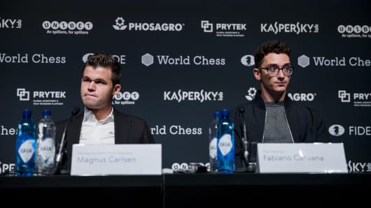 Magnus Carlsen and Fabiano Caruana attend the press conference of the FIDE World Chess Championship Match 2018 on November 08, 2018 in London, England.