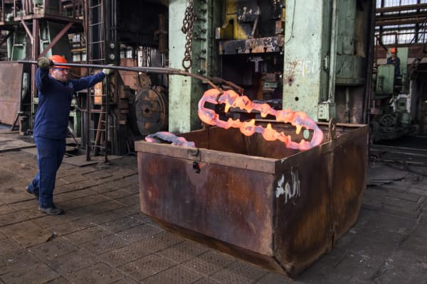 Man at work in a forging and mechanical plant.