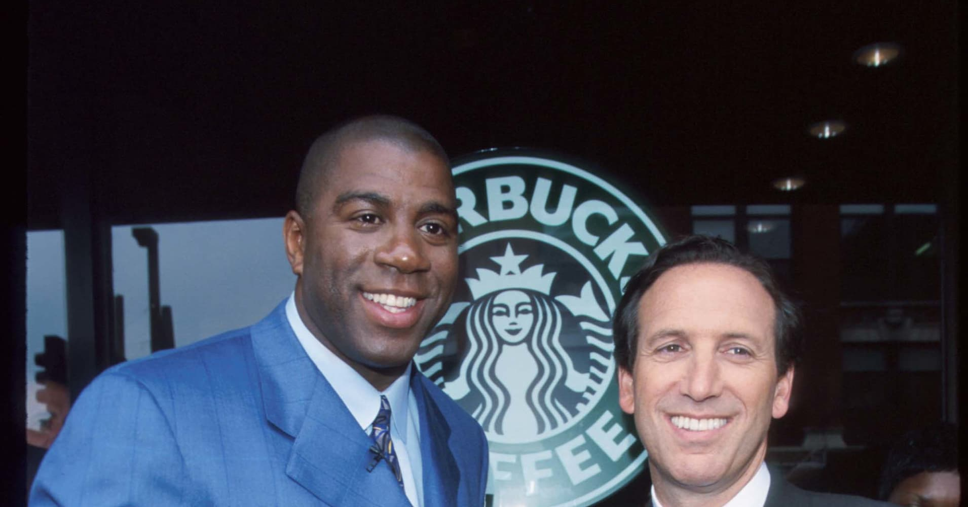 Earvin 'Magic' Johnson with Starbucks CEO Howard Schultz in 1999