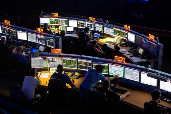 Scientists of an aerospace control center follow a rocket launch.