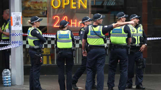 Police seen in Bourke St on Nov. 9, 2018 in Melbourne, Australia after a man was shot by police after he stabbed three people and killed one in Bourke St mall in Melbourne.
