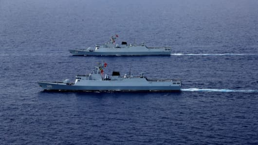 A People's Liberation Army Navy fleet  — including the aircraft carrier Liaoning, submarines, vessels and fighter jets —takes part in a review in the South China Sea on Apr. 12, 2018.