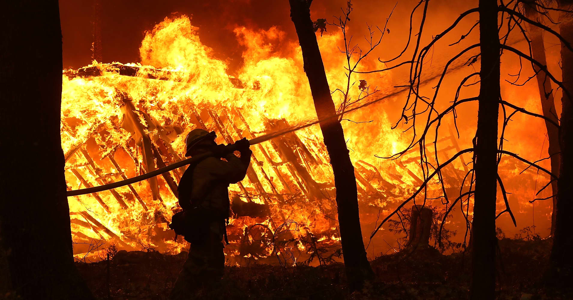 Fierce winds fan California wildfires, more than 200 missing