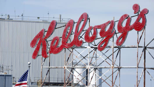 An American flag flies near signage displayed on top of the Kellogg plant in Memphis, Tennessee.