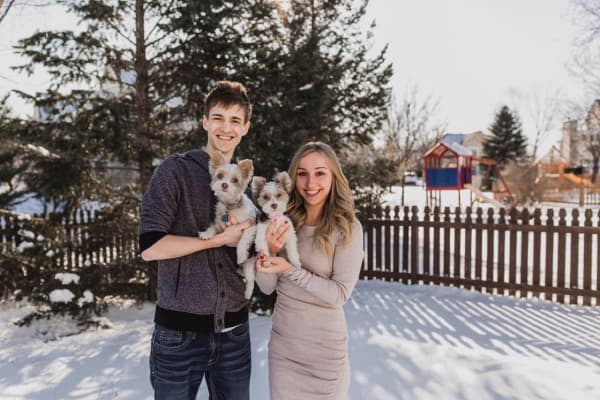 "Jess and Tyler ""Ninja"" Blevins with their dogs, Chance and Navi."