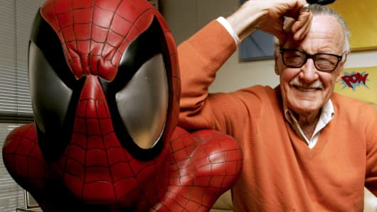 Stan Lee, founder of Marvel Entertainment Inc., poses for a photograph with a life size model of his superhero Spider-Man while in his office in Beverly Hills, California, U.S., on Thursday, Dec. 18, 2008.