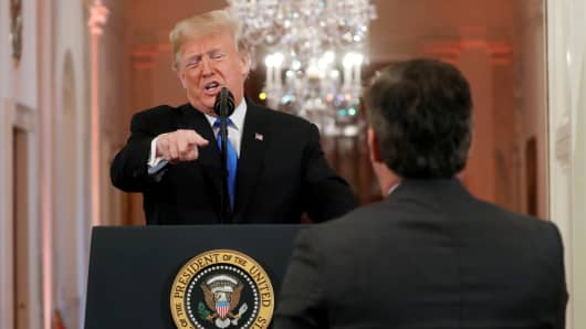 "President Donald Trump points at CNN's Jim Acosta and accuses him of ""fake news"" while taking questions during a news conference following Tuesday's midterm congressional elections at the White House in Washington, U.S., November 7, 2018."