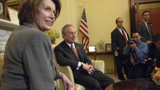 Then New York Mayor Michael Bloomberg and Speaker Nancy Pelosi pose for cameras for they met privately.