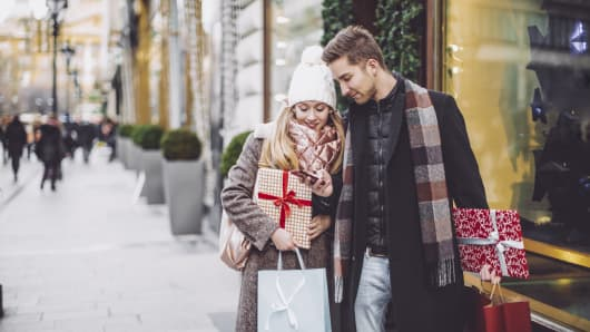 Young couple is buying Christmas presents