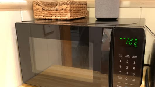 The Amazon microwave with an Amazon Echo Plus on top, which controls it.