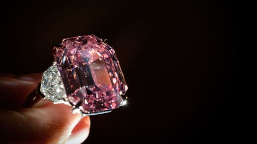 The Pink Legacy, a 18.96 carat fancy vivid pink diamond once owned by Oppenheimer family is displayed on November 8, 2018 during a press preview ahead of sales by Christie's auction house in Geneva