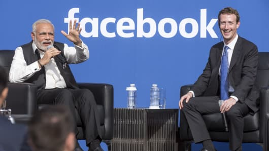 Narendra Modi, India's prime minister, left, speaks as Mark Zuckerberg, chief executive officer of Facebook, listens during a town hall meeting at Facebook headquarters in Menlo Park, California, U.S., on Sunday, Sept. 27, 2015.
