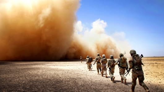 U.S. Marines and Georgian Army soldiers run to the extraction point during Operation Northern Lion II in Helmand province, Afghanistan, July 3, 2013.