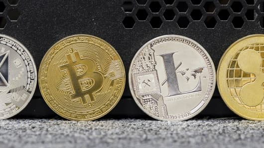 A photo illustration of the digital Cryptocurrency, Litecoin (LTC), Monero (XMR), Bitcoin (BTC), Ethereum (ETH), Ripple (XRP) and Dash are seen on September 13 2018 in Hong Kong, Hong Kong.