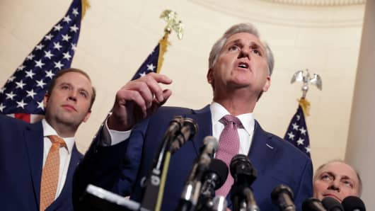 House Majority Leader Kevin McCarthy (R-CA) talks to reporters following his election to House minority leader for the next Congress with Rep. Jason Smith (R-MO) (L) and House Majority Whip Steve Scalise (R-LA) in the Longworth House Office Building on Capitol Hill November 14, 2018 in Washington, DC.
