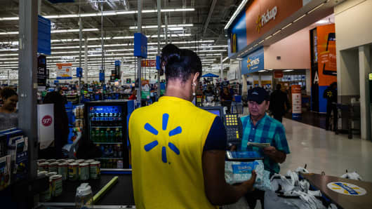 An employee scans a customer's purchases at a Walmart Inc. store in Secaucus, New Jersey, U.S., on Wednesday, May 16, 2018.