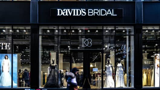 A pedestrian passes in front of a David's Bridal Inc. store in New York, U.S., on Wednesday, Nov. 14, 2018.