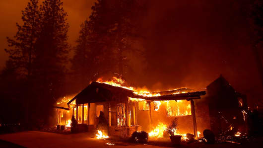 A home burns as the Camp Fire moves through the area on November 8, 2018 in Paradise, California.