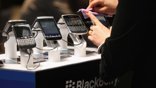 Visitors try out Blackberry smartphones on the first day of the CeBIT 2012 technology trade fair on March 6, 2012 in Hanover, Germany.