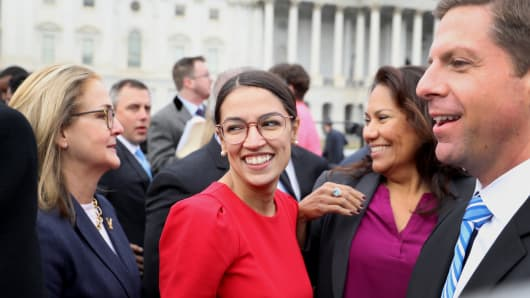 Representative-elect Alexandria Ocasio-Cortez, a Democrat from New York, smiles after a group photo with the 116th Congress outside the U.S Capitol in Washington, D.C., on Wednesday, Nov. 14, 2018.
