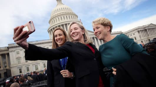 Newly elected members of the House of Representatives Abigail Spanberger (C) (D-VA), Mikie Sherrill (L) (D-NJ) and Chrissy Houlahan (D-PA) take a selfie in front of the U.S. Capitol following an official class picture of new representatives on November 14, 2018 in Washington, DC.