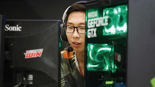 A gamer  plays a video game with the Graphic card GeForce during the 'Paris Games Week'on October 27, 2016 in Paris, France.
